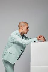 Man in green suit - minimal fashion