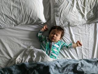 Baby sleeping in big bed