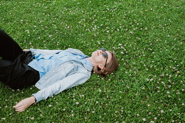 Woman lying on a grass
