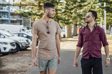 Male Friends Walking on a Path at Manly Beach, Australia.