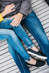 Couple laying embracing on a wooden bench