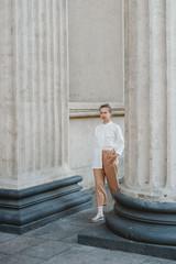 Young stylish woman walking