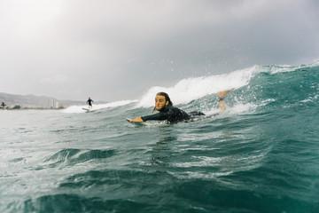 Man swimming on board
