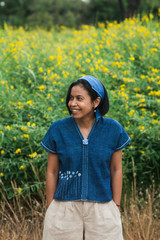 Asian woman wearing natural indigo dye cloth.