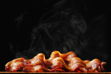 Pile of Sizzling Bacon Isolated on Black