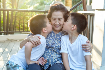 Happy Senior Asian Woman With Her Grandchildren