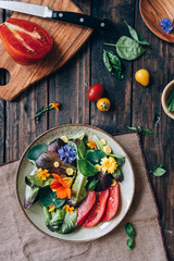 Delicious salad with edible flowers