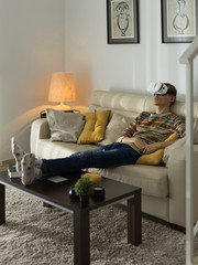 Man using VR goggles in living room