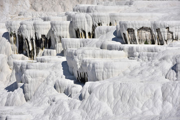 white travertine formations and tourist area