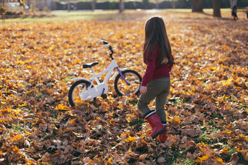 Girl in park full with autumn leafs
