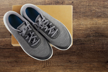 sports footwear on wooden background