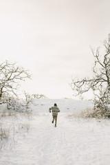 a man runs through the snow