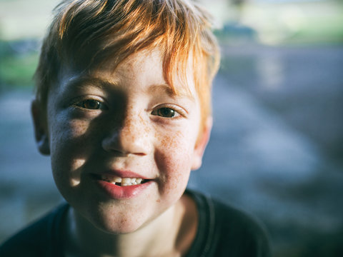 A young boy loses his first tooth