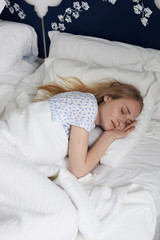 Young blond woman sleeping