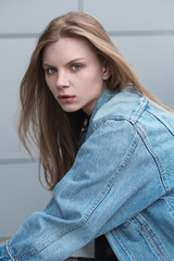 Portrait of a beautiful young girl in a denim jacket
