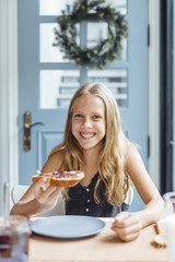 Young girl with toast with jam