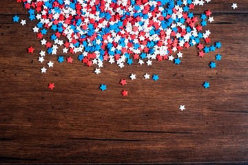 American Independence day background with blue, white and red mixed stars. Celebration of American independence day, the 4th of July (the Fourth of July). Holiday concept. Top view. With copy space.