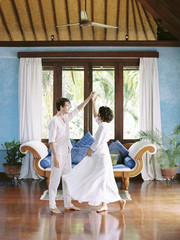 Couple dancing in beautifully decorated room