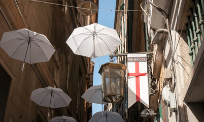 Genoa, Italy: detail of Via Luccoli, narrow alley in famous old town