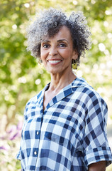 Closeup portrait of African American Senior woman in nature