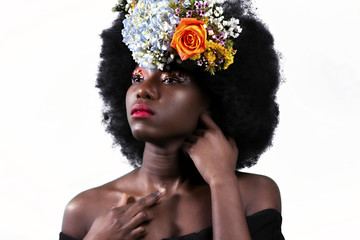 black woman with a beautiful Afro and flowers