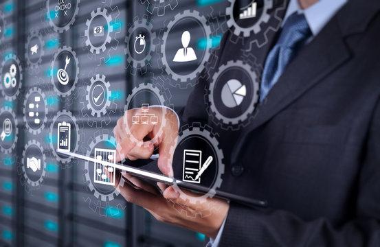 businessman  using tablet computer and server room background