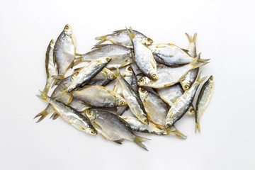 Dried fish on a white background. Flat lay, top view