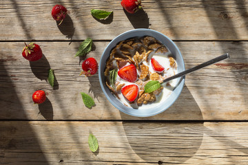 healthy breakfast, Cornflakes, cereal, fruit, milk, eating, morning, nutrition, gray bowlon, wooden background, top view. copy space