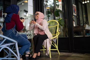 muslim malay woman is having a tea