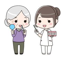 シニア女性に歯磨き指導をする歯科衛生士の女性(全身)