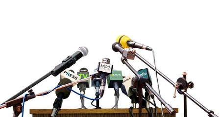 Press conference microphones on white background