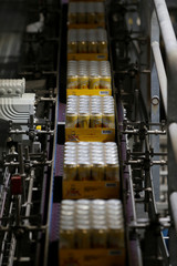 Cans of Cisk Lager are passed along a conveyor belt at the beer packaging facility at Farsons Brewery in Mriehel