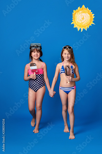 c41f951354a8c Studio summer portrait young 2 girls looking at camera. Beach vacation  concept. Girlfriends wear swimsuits,sunbathing,swimming in water,  warm,sunny day.