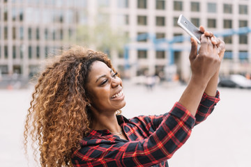 Happy young African woman posing for a selfie