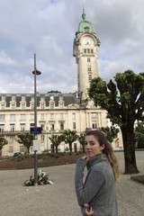 Teenager looking at camera in front of the Limoges station