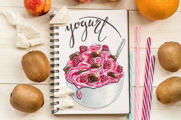 a bright yogurt hand-drawn illustration made with markers decorated with fruits and drinking straws on white wooden background