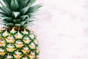 Pineapple close-up on a wooden light background. Summer concept. Flat lay, top view, copy space