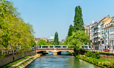 City tram crossing the Ill river in Strasbourg, France