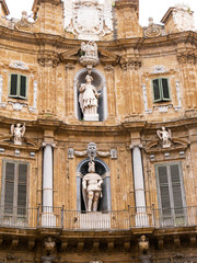 Palermo, Italy April, 2018: Statue of Philip IV and Saint Catherine at the Quattro Canti, Palermo Baroque facade at the sout-east corner in the historic center of Palermo