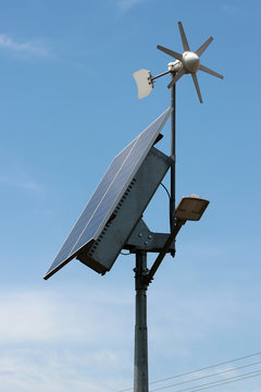 Self-powered street LED lamp with solar panel and wind generator