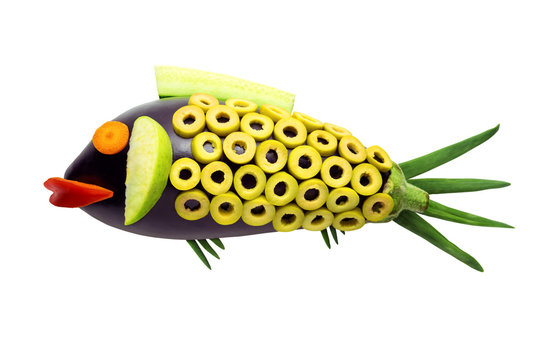 Vegetable fish / Creative concept photo of fish made of fruits and vegetables on white background.