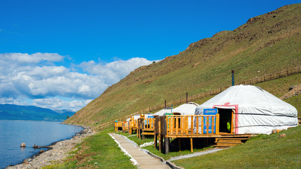 Tourist center in Mongolia on the shore of Lake Hovsgol. Yurts - a traditional home in Mongolia. Aspect ratio 16:9