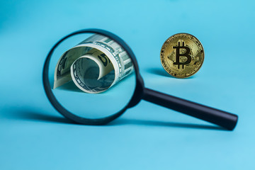 Magnifier glass with golden bitcoin coin. dollar is bitcoin