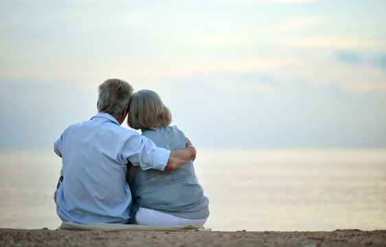 Senior couple looking a sea