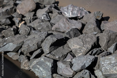 Close up of Manganese rock being moved on a conveyor belt
