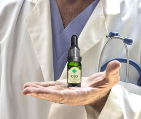Closeup of Doctors hands holding a CBD oil bottle