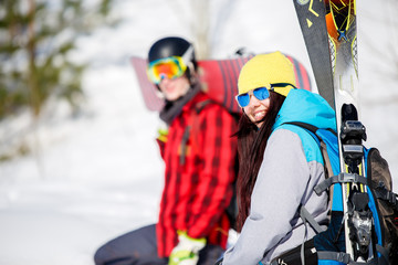 Photo of sports men and women with mountain skis walking on snow hill