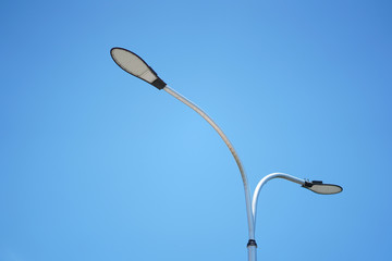 LED street lights on the road with blue sky background. Fotomurales