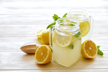 Summer healthy non alcoholic cocktails, citrus infused water drinks, lemonades with lime lemon or orange, diet detox beverages.