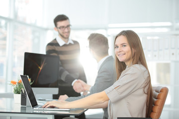young business woman on blurred office background